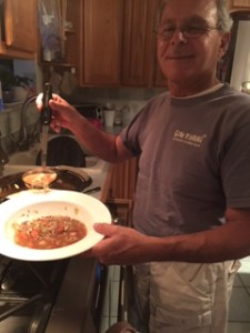 Paul, my husband, helping himself to a second plate of chicken vegetable soup.