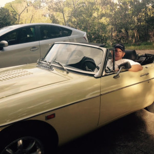 My husband, in one of his classic British cars.